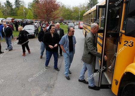 Levon Helm People board buses to go to a wake for musician Levon Helm t his home in Woodstock, N.Y., on . Helm, a former member of The Band, four-time Grammy Award winner and member of the Rock and Roll Hall of Fame died last week at age 71 after a battle with cancer