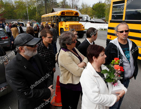Levon Helm People wait to board buses to go to a wake for musician Levon Helm at his home in Woodstock, N.Y., on . Helm, a former member of The Band, four-time Grammy Award winner and member of the Rock and Roll Hall of Fame died last week at age 71 after a battle with cancer