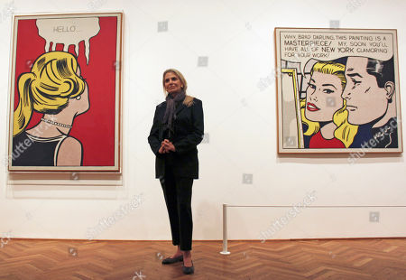 """Stock Image of Dorothy Lichtenstein, Roy Lichtenstein Dorothy Lichtenstein, widow of pop artist Roy Lichtenstein, stands between his artworks """"Cold Shoulder,"""" left, and """"Masterpiece"""" at the Art Institute of Chicago. The museum has opened """"Roy Lichtenstein: A Retrospective,"""" which runs through Sept. 3 before traveling to Washington, London and Paris"""