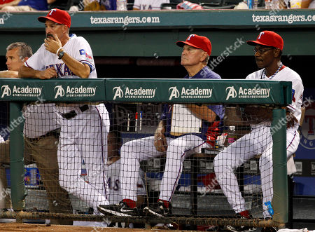 Mike Maddux, Ron Washington, Jackie Moore From left to right, Texas Rangers pitching coach Mike Maddux, bench coach Jackie Moore and manager Ron Washington look on in the ninth inning of baseball game against the Seattle Mariners, in Arlington, Texas. The Mariners won 21-8