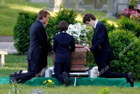 Robert Kennedy Jr Robert F. Kennedy Jr., left, kneels with his children at the casket of Mary Richardson Kennedy, in St. Francis Xavier Cemetery in Centerville, Mass., . Mary Richardson Kennedy was found dead of an apparent suicide last week at her home in Bedford, N.Y