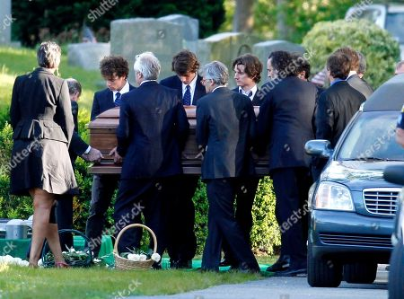 Family members carry the casket of Mary Richardson Kennedy, the estranged wife of Robert F. Kennedy Jr., at the grave site in St. Francis Xavier Cemetery in Centerville, Mass., . Kennedy was found dead of an apparent suicide last week at her home in Bedford, N.Y
