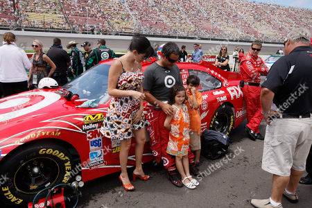 Juan Pablo Montoya, Connie Montoya, Sebastian Montoya, Pauline Montoya NASCAR driver Juan Pablo Montoya stands next to his car with wife Connie, son Sebastian and daughter Paulina before the Quicken Loans 400 auto race at Michigan International Speedway in Brooklyn, Mich