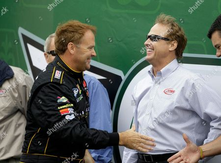 Mike Wallace, Rusty Wallace Mike Wallace, left, greets Rusty Wallace before the NASCAR Nationwide Series' Pioneer Hi-Bred 250 auto race, at Iowa Speedway in Newton, Iowa