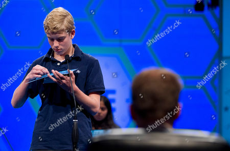 """John Fulton John Fulton, of Lancaster, Penn., works on spelling his word """"gnathonic"""" during the second round of the National Spelling Bee on in Oxon Hill, Md"""