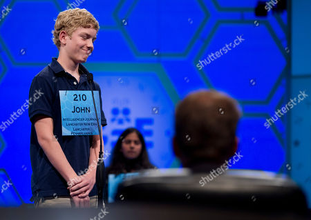 """John Fulton John Fulton, of Lancaster, Penn., reacts after spelling his word """"gnathonic"""" incorrectly during the second round of the National Spelling Bee on in Oxon Hill, Md"""