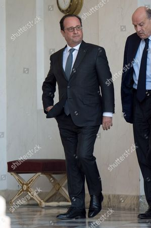 French President Francois Hollande and French Junior Minister for Parliamentary Relations Jean-Marie Le Guen at the Elysee Palace in Paris, France, following the weekly cabinet meeting