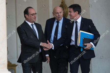 French President Francois Hollande, Prime Minister Manuel Valls and French Junior Minister for Parliamentary Relations Jean-Marie Le Guen at the Elysee Palace in Paris, France, following the weekly cabinet meeting