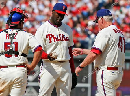 Charlie Manuel, Carlos Ruiz, Jose Contreras Philadelphia Phillies manager Charlie Manuel, right, takes the ball from pitcher Jose Contreras during the eighth inning of a baseball game, in Philadelphia. At left is catcher Carlos Ruiz. The Phillies won 3-2