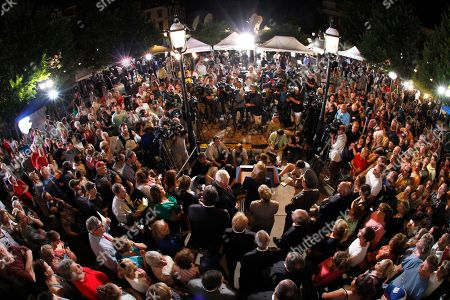 With a fisheye lens shows a crowd of people gather in front of the Centre County Courthouse as Pennsylvania Attorney General Linda Kelly speaks, center, after former Penn State University assistant football coach Jerry Sandusky was found guilty of multiple charges of child sexual abuse in Bellefonte, Pa