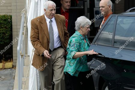 Jerry Sandusky, Dottie Sandusky, Denny Nau Former Penn State University assistant football coach Jerry Sandusky, left, and his wife Dottie leaves the Centre County Courthouse past Centre County Sheriff Denny Nau in Bellefonte, Pa., . Jerry Sandusky is charged with 51 counts of child sexual abuse involving 10 boys over a period of 15 years