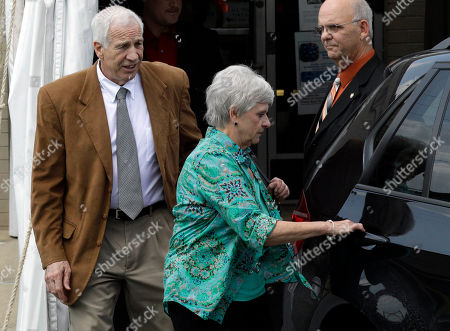 Jerry Sandusky, Dottie Sandusky, Denny Nau Former Penn State University assistant football coach Jerry Sandusky, left, and his wife Dottie, center, leave the Centre County Courthouse past Centre County Sheriff Denny Nau, in Bellefonte, Pa., . Jerry Sandusky is charged with 51 counts of child sexual abuse involving 10 boys over a period of 15 years. Centre County Sheriff Denny Nau is right