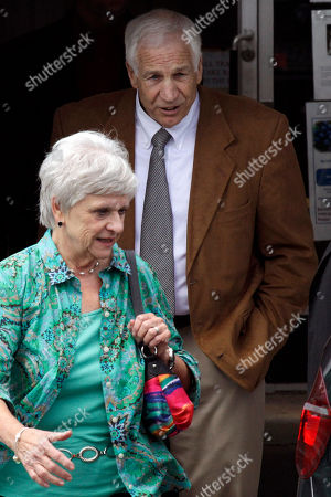 Jerry Sandusky, Dottie Sandusky Former Penn State University assistant football coach Jerry Sandusky, rear, and his wife Dottie leave the Centre County Courthouse in Bellefonte, Pa., . Sandusky is charged with 51 counts of child sexual abuse involving 10 boys over a period of 15 years