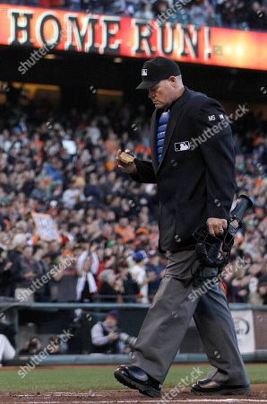 Ted Barrett Home plate umpire Ted Barrett stands over home plate after San Francisco Giants first baseman Brandon Belt hit a two-run home run off of Houston Astros pitcher J.A. Happ during the second inning of a baseball game in San Francisco, . Barrett was behind the plate Wednesday night when San Francisco Giants' right-hander Matt Cain pitched a perfect game against the Houston Astros in a 10-0 victory. He also was the home plate umpire when David Cone threw his perfect game for the New York Yankees in a 6-0 win over the Montreal Expos on July 18, 1999. It makes Barrett the first major league umpire to call balls and strikes for two perfect games