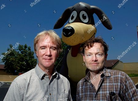 """Brandon Camp, Mark Forbes Brandon Camp, right, writer, producer and director of the upcoming feature film remake of """"Benji,"""" and animal trainer Mark Forbes, pose in front of a large inflated figure of a dog at the Best Friends Animal Society shelter in the Mission Hills area of Los Angeles. Camp, whose father created """"Benji"""" nearly 40 years ago, and veteran movie trainer Forbes have set out to find a new Benji in a nationwide search that includes online tools and sites that weren't around when the first four Benjis were discovered"""
