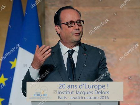 French President Francois Hollande, gestures as he speaks during an event for the 20th anniversary of the Jacques Delors institute in Paris