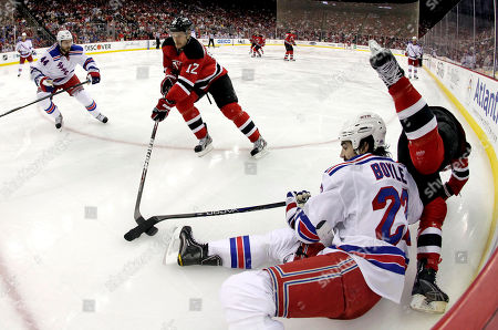 Adam Henrique, Brian Boyle, Steve Eminger, Alexei Ponikarovsky In this image taken with a fisheye lens, New Jersey Devils' Adam Henrique, right, flips over New York Rangers' Brian Boyle (22) during the second period of Game 3 of an NHL hockey Stanley Cup Eastern Conference final playoff series, in Newark, N.J. The Devils' Alexei Ponikarovsky (12), of Ukraine, reaches for the puck as Rangers Steve Eminger (44) skates in
