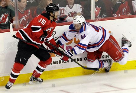 Jacob Josefson, Steve Eminger New Jersey Devils' Jacob Josefson, of Sweden, left, struggles with New York Rangers' Steve Eminger during the first period of Game 4 of an NHL hockey Stanley Cup Eastern Conference final playoff series, in Newark, N.J