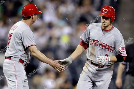 Zach Cozart, Mike Berry Cincinnati Reds' Zach Cozart, right, rounds third past coach Mike Berry after hitting a solo-home run off Pittsburgh Pirates pitcher Kevin Correia in the seventh inning of a baseball game in Pittsburgh