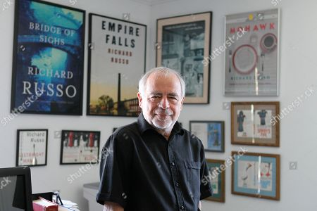 Richard Russo In this photo made, Pulitzer-winning novelist Richard Russo poses at his home in Camden, Maine