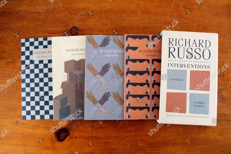 "Richard Russo In this photo made, Interventions, four individually bound volumes gathered in a slipcase-combines the previously unpublished novella ""Intervention"" with three shorter works by a Pulitzer Prize-winning novelist Richard Russo, are seen in Camden, Maine"