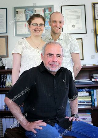 Stock Photo of Richard Russo, Kate Russo, Tom Butlert In this photo made, Pulitzer Prize-winning novelist Richard Russo, seated, poses with his daughter, artist Kate Russo, and her husband, designer Tom Butler, at his home in Camden, Maine. The trio collaborated on Russo's latest work
