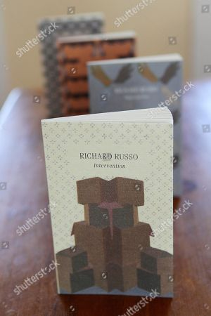 """Stock Image of Richard Russo In this photo made, """"Interventions,"""" which are four individually bound volumes gathered in a slipcase, combining the previously unpublished novella """"Intervention"""" with three shorter works by Pulitzer Prize-winning novelist Richard Russo, sit on display in Camden, Maine"""