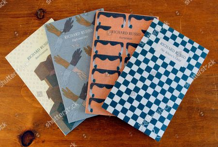 "Stock Image of Richard Russo In this photo made, ""Interventions,"" which are four individually bound volumes gathered in a slipcase, combining the previously unpublished novella ""Intervention"" with three shorter works by Pulitzer Prize-winning novelist Richard Russo, lie on display in Camden, Maine"