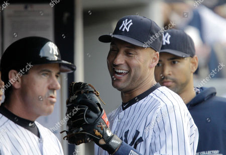 Rob Thomson, Derek Jeter, Corey Wade New York Yankees relief pitcher Cory Wade, right, watches as Yankees shortstop Derek Jeter laughs with third base coach Rob Thomdon in the dugout during their baseball game against the Kansas City Royals at Yankee Stadium in New York