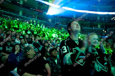 Jordan Nolan, Dwight Kings, Jeff Carter Los Angeles Kings fans Steve Silver and Lynette Silver clap as the players are introduced during a rally celebrating the team's NHL hockey Stanley Cup championship in Los Angeles