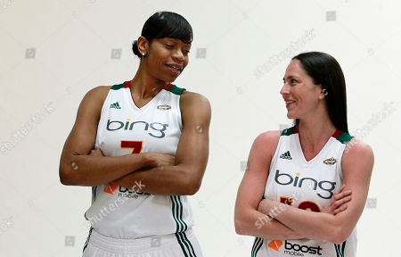 Tina Thompson, Sue Bird Seattle Storm's Tina Thompson, left, and Sue Bird look across at each other while being photographed during a media day for the basketball team, in Seattle. The Storm opens their season Friday, May 18, against the Los Angeles Sparks