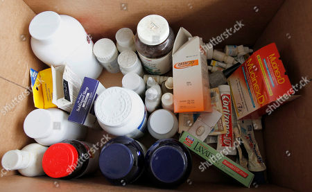 Bottles and boxes of surplus and expired medications that Kathy Burke of Gibsonia, were brought to the Allegheny County police station in North Park to be disposed of, in Allison Park, Pa. This collection point is just one that is part of the the fourth National Prescription Drug Take Back Day hosted by the federal Drug Enforcement Administration. The goal is to help prevent abuse of their purpose, to keep the drugs away from children they weren't intended for and to dispose of them in a safe and controlled manner. Burke said she collected many of them from her mother's home after she passed away