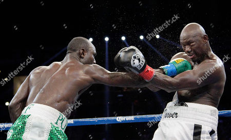 Antonio Tarver, Lateef Kayode Antonio Tarver, right, takes a punch from Lateef Kayode, of Nigeria, in the 12th round of a cruiserweight boxing match in Carson, Calif., . The fight ended in a draw