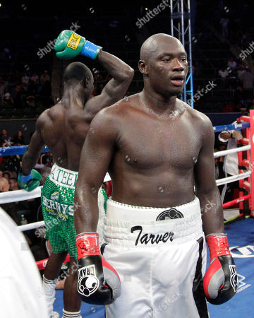 Antonio Tarver, Lateef Kayode Antonio Tarver, center, walks away from Lateef Kayode, of Nigeria, after their cruiserweight boxing match in Carson, Calif., . The fight ended in a draw