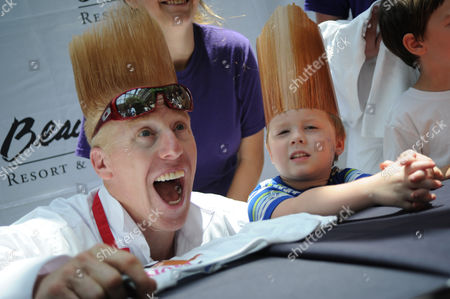 Coast aerial walk, tightrope, high wire Comic and daredevil performer Bello Nock, left, laughs as he signs an autograph for Mason Johnson, 6, after Nock performed a high-wire stunt at the Beau Rivage Resort & Casinio in Biloxi, Miss. on . Nock walked across a tightrope suspended 32 stories high between spans of the Beau Rivage to promote an upcoming show by Fata Morgana, a group of dancers, acrobats, and aerialists, that begins June 26 at the Beau Rivage