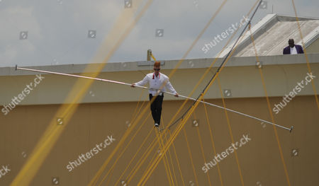 Tightrope Comic and daredevil performer Bello Nock begins a walk across a tightrope suspended 32 stories high between spans of the Beau Rivage Resort & Casino in Biloxi, Miss. on . Nock performed the high wire stunt to promote an upcoming show by Fata Morgana, a group of dancers, acrobats, and aerialists, that begins June 26 at the Beau Rivage