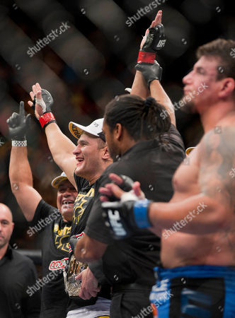 Frank Mir, Junior Dos Santos Junior Dos Santos, left, reacts after defeating Frank Mir by knockout in the second round during a UFC 146 heavyweight title bout, in Las Vegas