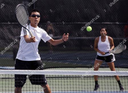 Stock Photo of Alejandra Castillo, Josh Gomez Fort Hancock's Josh Gomez, left, and Alejandra Castillo, right, compete in the quarterfinals of the Class A Tennis tournament, in Austin, Texas