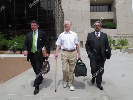 Stock Photo of Christopher Tappin, center, leaves federal court with his lawyers Dan Cogdell, right, and Kent Schaffer, in El Paso, Texas. Tappin, who was brought to Texas to face charges that he tried to sell missile parts to Iran, was released from U.S. custody Wednesday on $1 million bond
