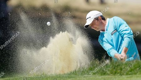 Peter Lawrie, of Ireland, hits out of a bunker on the sixth hole during the first round of the U.S. Open Championship golf tournament, at The Olympic Club in San Francisco