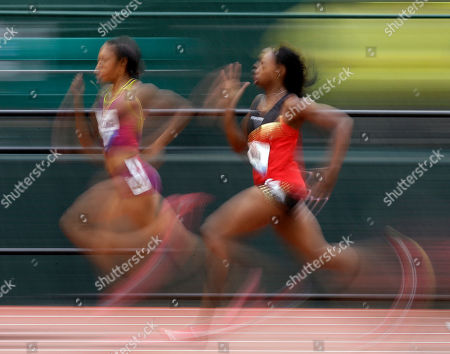 Stock Picture of Natasha Hastings, left, and Keshia Baker compete in the women's 400m preliminary at the U.S. Olympic Track and Field Trials, in Eugene, Ore