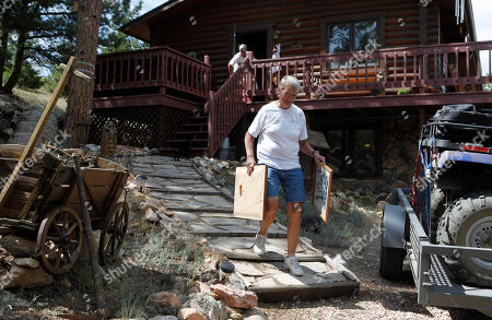 Stock Image of High Park Wildfire Shirley Paskett, front, and her partner Pam Creech evacuate their home after the High Park wildfire crossed to the north side of Poudre Canyon the Glacier View area near Livermore, Colo., on . The fire is burning on more than 68,000 acres west of Fort Collins and has destroyed at least 189 homes