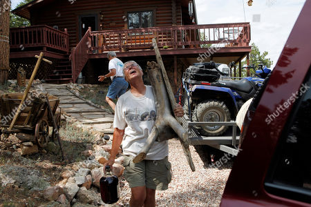 High Park Wildfire Pam Creech, front, laughs as she and her partner Shirley Paskett evacuate their home after the High Park wildfire crossed to the north side of Poudre Canyon the Glacier View area near Livermore, Colo., on . The fire is burning on more than 68,000 acres west of Fort Collins and has destroyed at least 189 homes