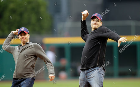 Mike Greenberg, Mike Golic ESPN radio hosts Mike Greenberg, left, and Mike Golic throw out first pitches before a baseball game between the Cleveland Indians and the Chicago White Sox, in Cleveland