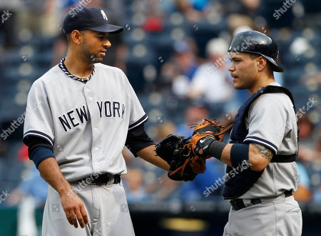 Cory Wade, Russell Martin New York Yankees relief pitcher Cory Wade, left, is congratulated by catcher Russell Martin following a baseball game against the Kansas City Royals in Kansas City, Mo., . The Yankees defeated the Royals 10-4