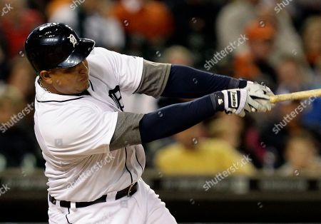 Miguel Cabrera Detroit Tigers' Miguel Cabrera hits a solo home run off New York Yankees relief pitcher Cory Wade in the eighth inning of a baseball game in Detroit