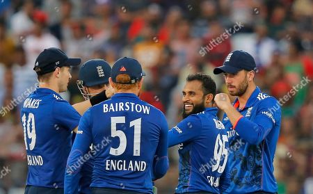 England's Adil Rashid, second right, celebrates with his teammates the dismissal of Bangladesh's Nasir Hossain during the third one-day international cricket match in Chittagong, Bangladesh
