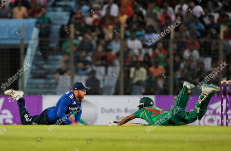 England's Jonny Bairstow, left, dives to breaks the stumps, as Bangladesh's Nasir Hossain dives to complete a run during their third one-day international cricket match in Chittagong, Bangladesh
