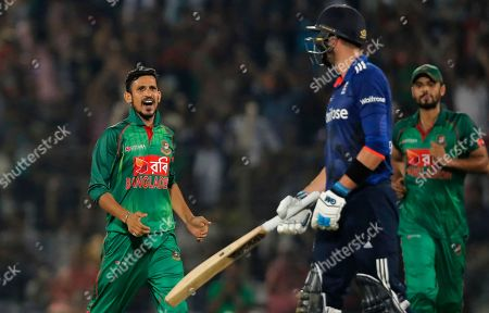 Bangladesh's Nasir Hossain, left, celebrates the dismissal of England's James Vince, second left, during their third one-day international cricket match in Chittagong, Bangladesh