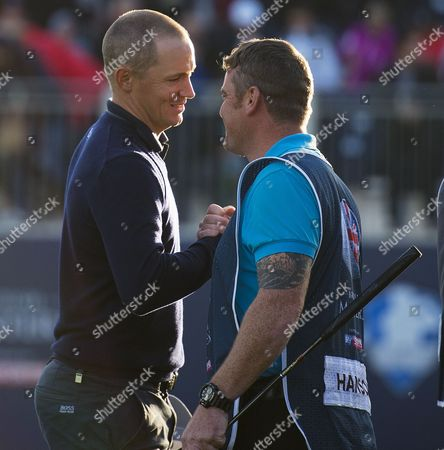 ALEX NOREN IS CONGRATULATED BY PETER HANSON?S CADDIE